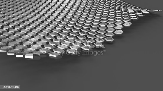 istock The steel hexagons in wave form levitating above gray surface. Abstract industrial background 992323986