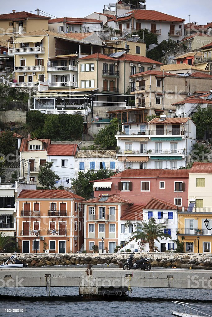 The steep hillside town and harbour area of Parga, Greece royalty-free stock photo