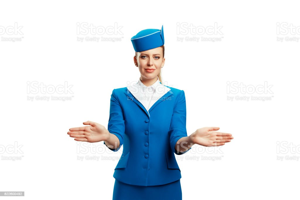 The stewardess indicates the direction of the emergency exits from the aircraft. stock photo