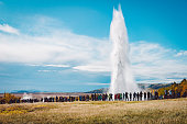 A crowd admiring an eruption of Stokkur geyser on Iceland