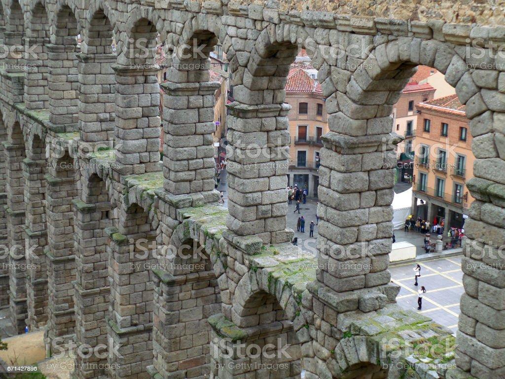 the stone arches of roman aqueduct of segovia spain stock photo