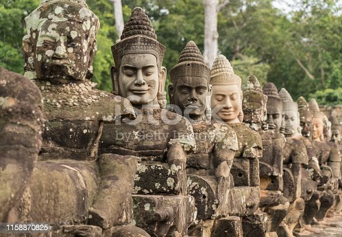 The stone carving on the bridge before go inside angkor thom kingdom, siem reap, cambodia
