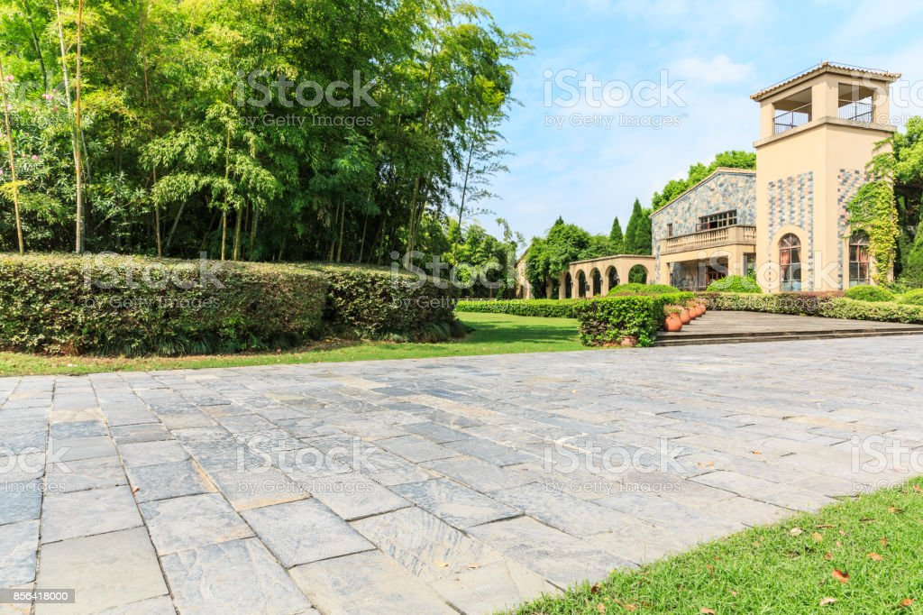 The stone floor road in front of urban suburban apartments stock photo