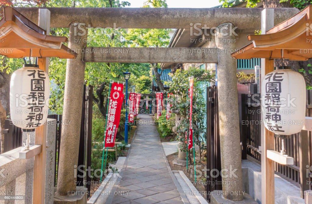The Stone gate passage for Toshogu shrine in Ueno park. stock photo