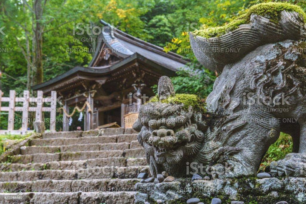 The stone guardian dog of Togakushi Shrine stock photo