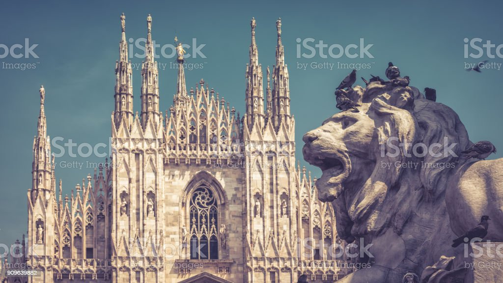 The stone lion on Cathedral Square in Milan, Italy stock photo
