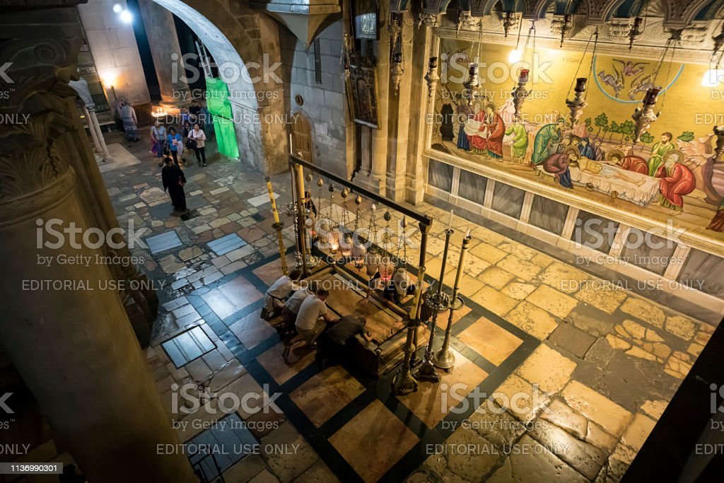 The Stone of the Anointing The Stone of Unction in Church of the Resurrection, Old City of JERUSALEM, ISRAEL. 24 October 2018 stock photo