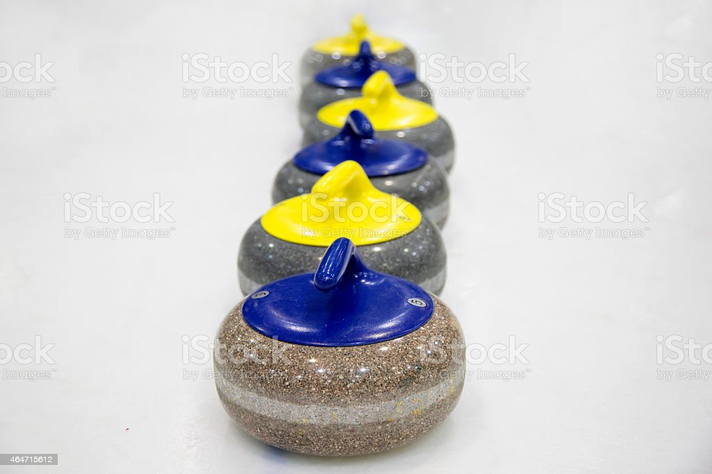The stones for game in curling stock photo