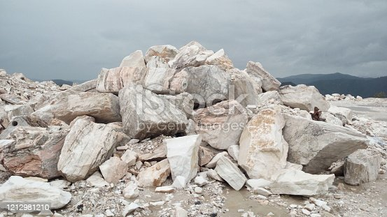 Stones of a marble mountain against the gloomy sky.