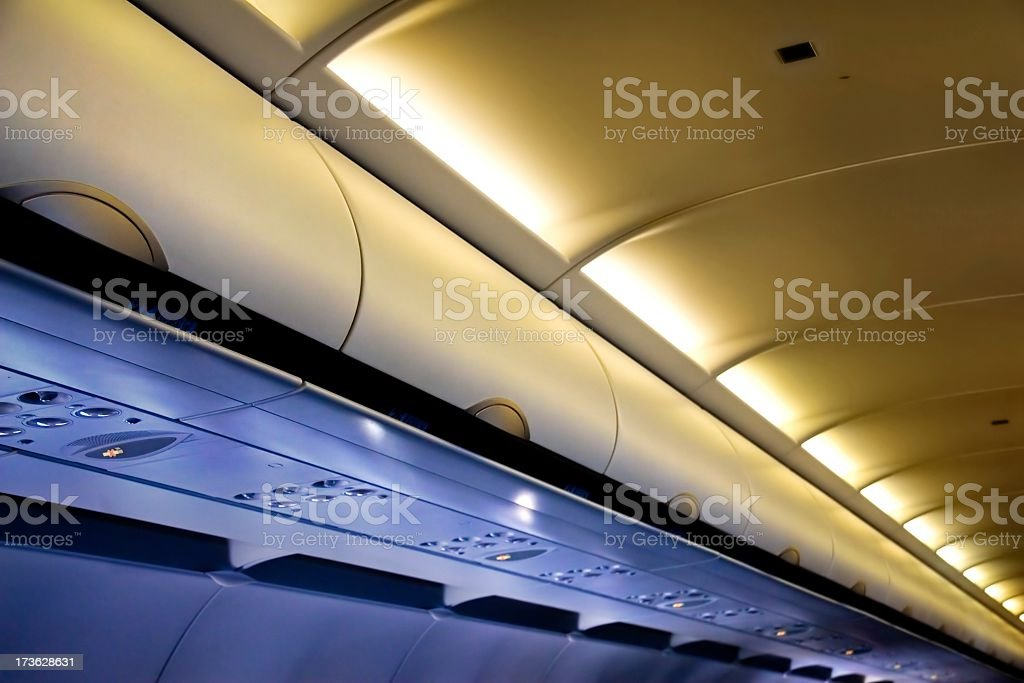 The storage compartments above your seat on a plane stock photo