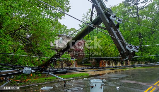 istock The storm caused severe damage to electric poles falling tilt. 960097910