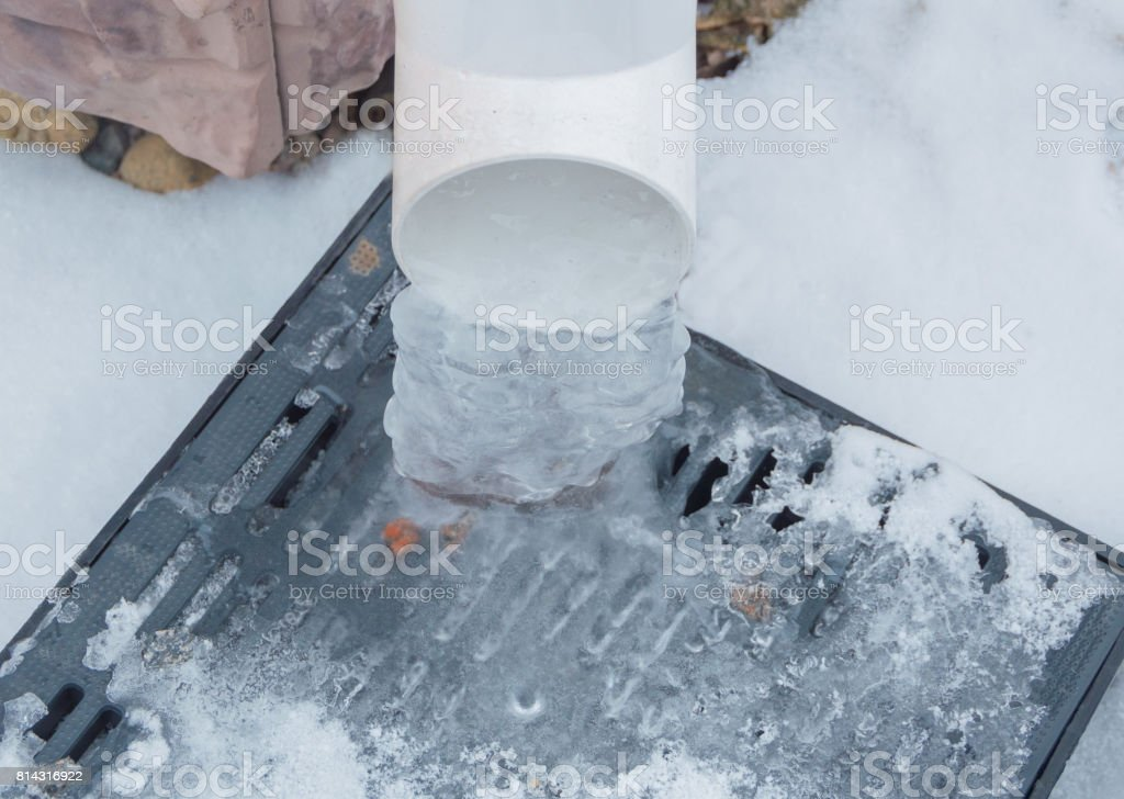 the stormwater drainage in the winter cold stock photo