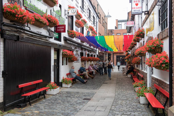The street Commercial Court with the proud gay colors in Belfast, UK. stock photo