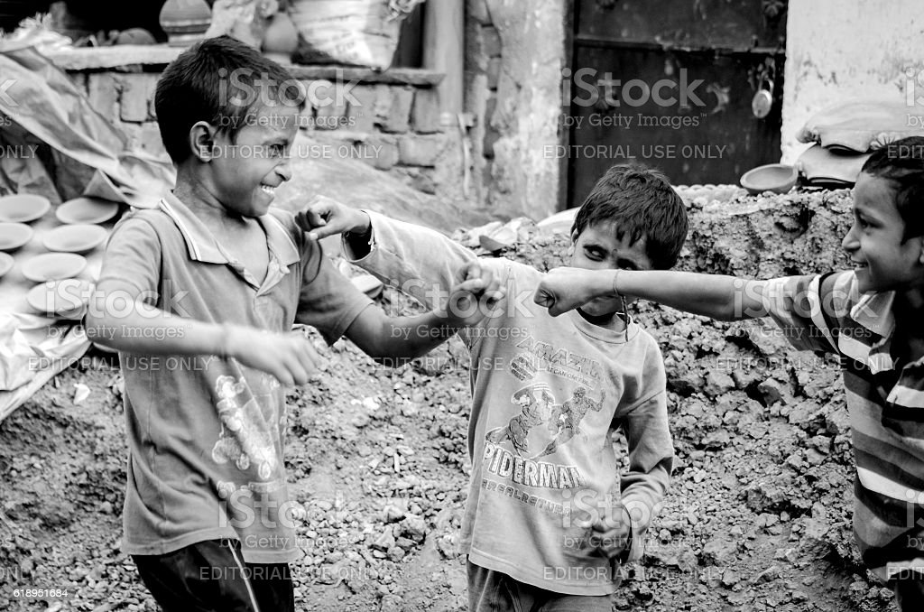 The street Fight-street children fighting at New Delhi India stock photo