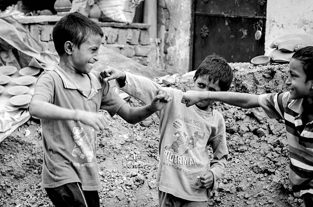 the street fight-street children fighting at new delhi india - disinherit stock pictures, royalty-free photos & images
