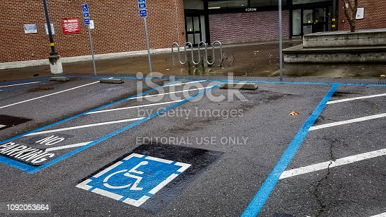 The restricted area of parking the cars for the regular people. The photo was taken by the photographer on the 9th of January, 2019 nearby Laney College in Oakland, CA.