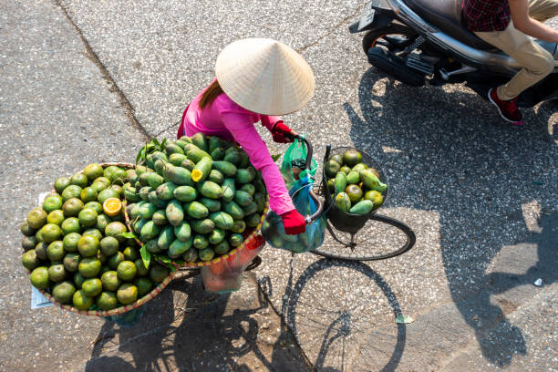 The street vendor in early morning in Hanoi, capital of Vietnam The street vendor in early morning in Hanoi, capital of Vietnam hanoi stock pictures, royalty-free photos & images