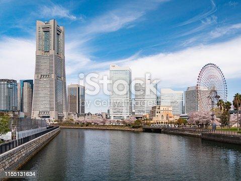 The streets of Yokohama Minatomirai with cherry blossoms in Yokohama City, Kanagawa Prefecture, Japan. Yokohama MinatoMirai is an area facing Yokohama Port.