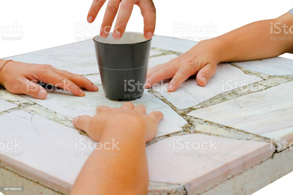 The struggle,hand on table with the cup on white background. stock photo