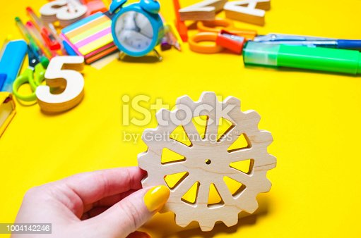 istock the student holds a gear in his hands. educational process. principle of action, creativity and education system. development of young children. imagination. school desk. 1004142246