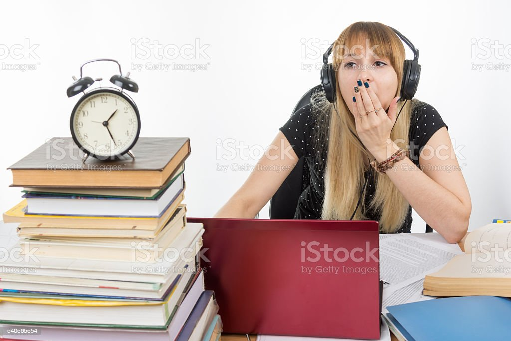 The student later dedicated the night yawns at his laptop stock photo