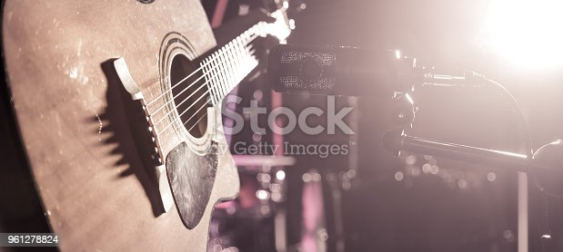 istock The Studio microphone records an acoustic guitar close-up. Beautiful blurred background of colored lanterns. 961278824