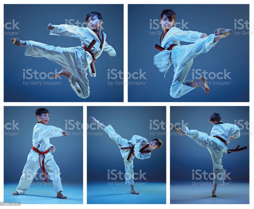 The studio shot of kids training karate martial arts stock photo