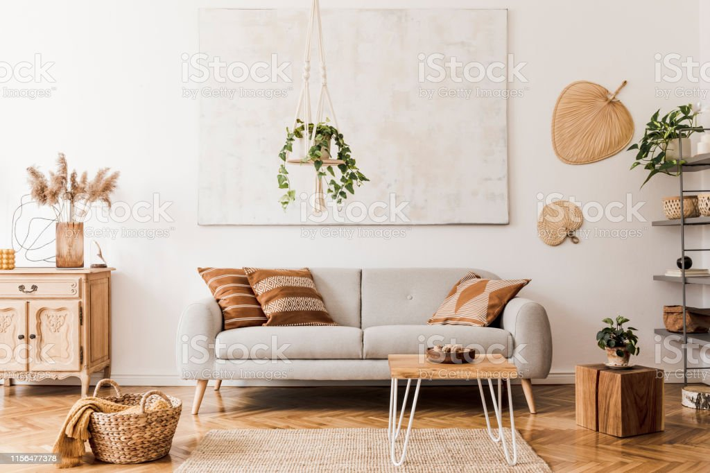 Picture of: The Stylish Boho Compostion At Living Room Interior With Design Gray Sofa Wooden Coffee Table Commode And Elegant Personal Accessories Honey Yellow Pillow And Plaid Cozy Apartment Home Decor Stock Photo
