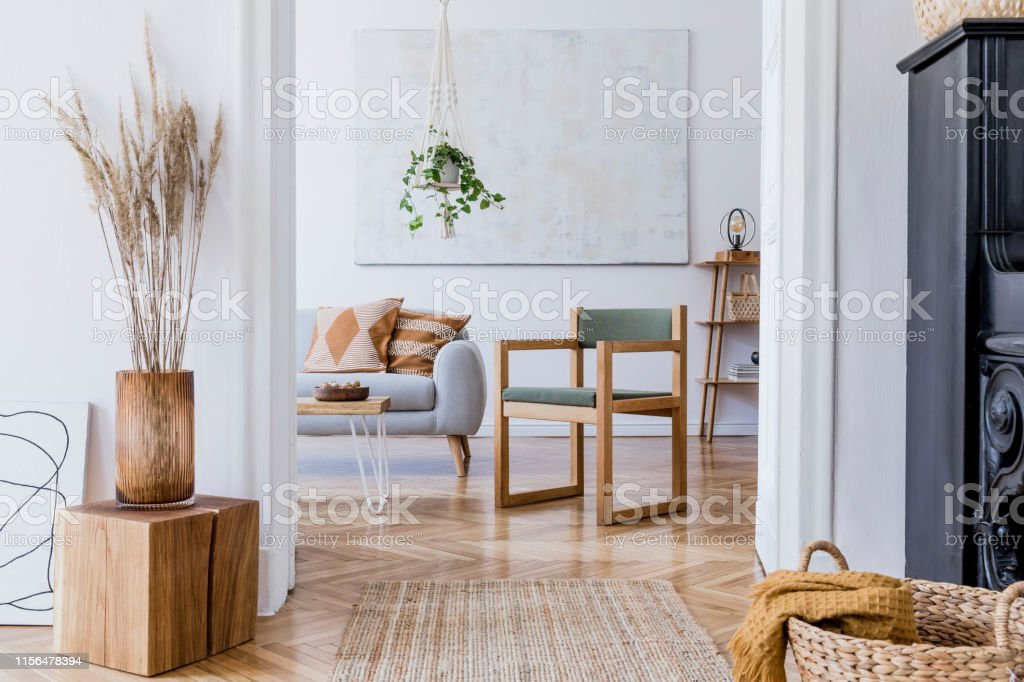 Picture of: The Stylish Boho Interior Of Living Room In Cozy Apartment With Design Coffee Table Gray Sofa Honey Yellow Pillows Piano Green Armchair Plants And Elegant Personal Accessories Modern Home Decor Stock Photo