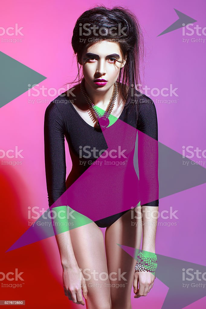 The stylish girl model on a pink-violet background. stock photo