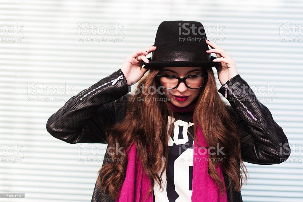the stylish girl puts on a classical hat stock photo