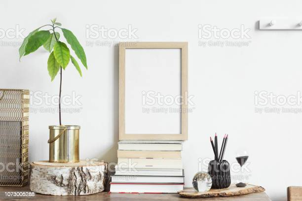 The stylish interior with mock up poster frame plants books and the picture id1073005288?b=1&k=6&m=1073005288&s=612x612&h=bsvidhzksqe8ch6lca9c05ty4fytdoyncdivnogpung=
