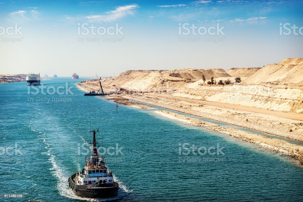 The Suez Canal - a ship convoy passes through the new eastern extension canal stock photo
