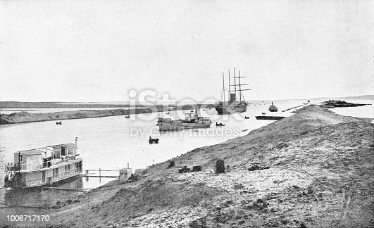 The Suez Canal in Egypt. Vintage halftone photo etching circa late 19th century.