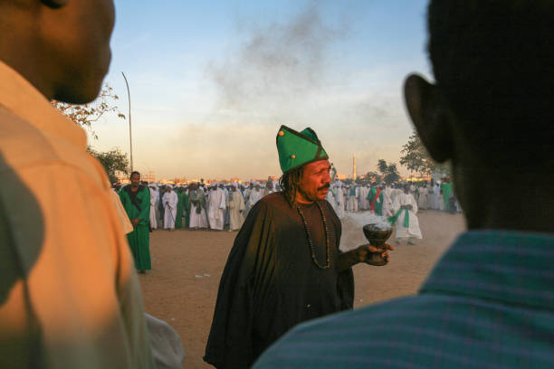 The Sufi whirling Dervishes dancers of Omdurman, Khartoum, Sudan Omdurman, Khartoum, Sudan - January 29, 2010: every Friday afternoon at sunset the Sufi Whirling Dervishes dressed in colorful clothes gather in circle next to the Hamed al Nil mosque to sing and perform their ritual dances, whirling and filling the air with the perfume of frankincense. Khartoum is the capital and largest city of Sudan, located at the confluence of the White Nile, flowing north from Lake Victoria in Uganda, and the Blue Nile, flowing west from Ethiopia. Khartoum is composed of 3 cities: Khartoum proper, Khartoum North and Omdurman. omdurman stock pictures, royalty-free photos & images
