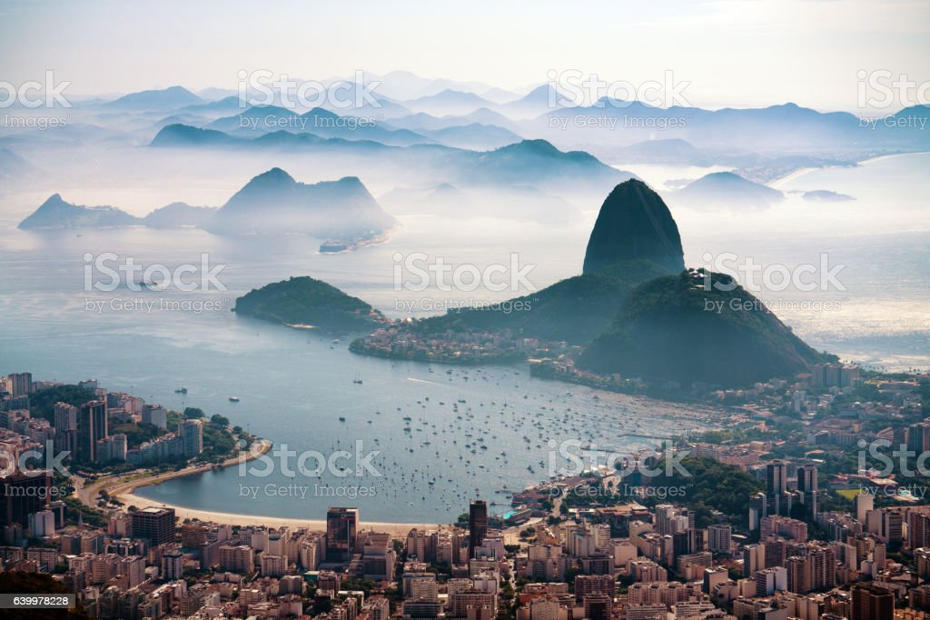 The Sugarloaf mountain in morning mist and Botafogo bay stock photo