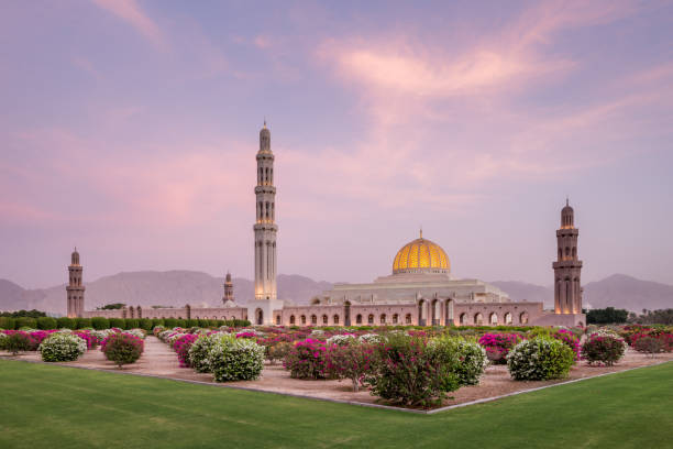The Sultan Qaboos Grand Mosque in the middle east, Oman, Muscat, at sunset. stock photo