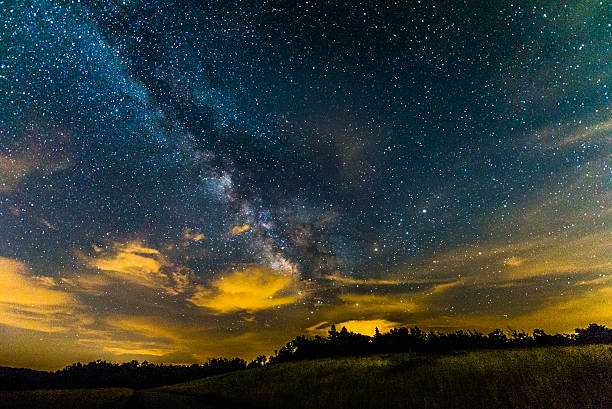 The Summer Milky Way From Shenandoah National Park, Virginia The Milky Way rises over the Blue Ridge Mountains in Shenandoah National Park. The galactic core is visible near the horizon. blue ridge mountains stock pictures, royalty-free photos & images