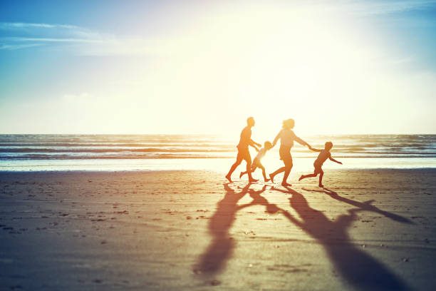 the summer sun brings family fun - family vacation stock photos and pictures