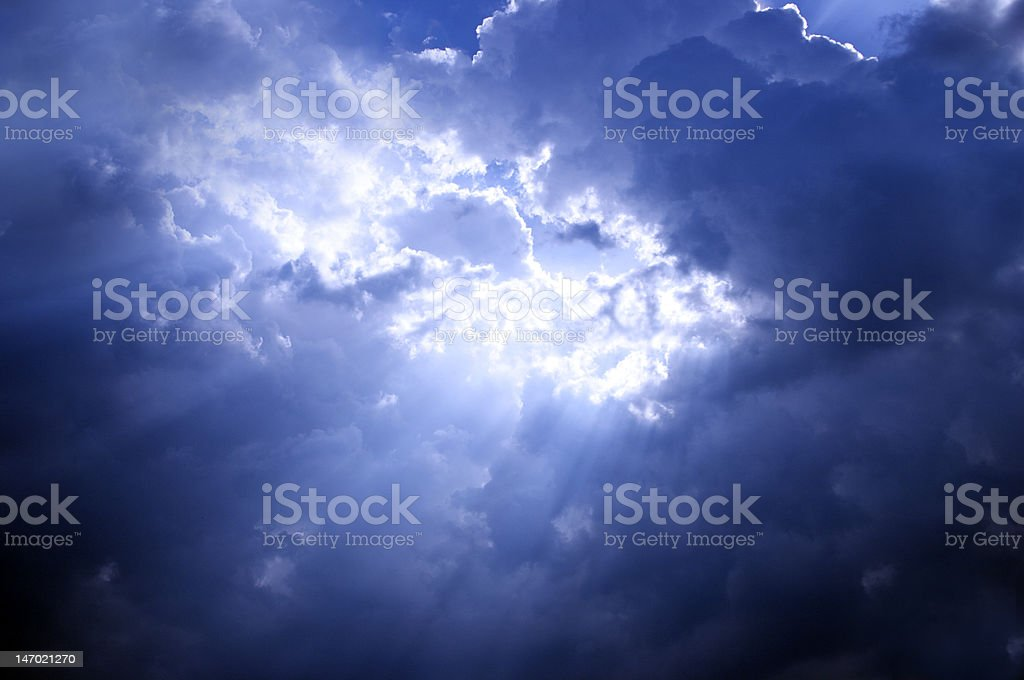The sun behind dark clouds royalty-free stock photo