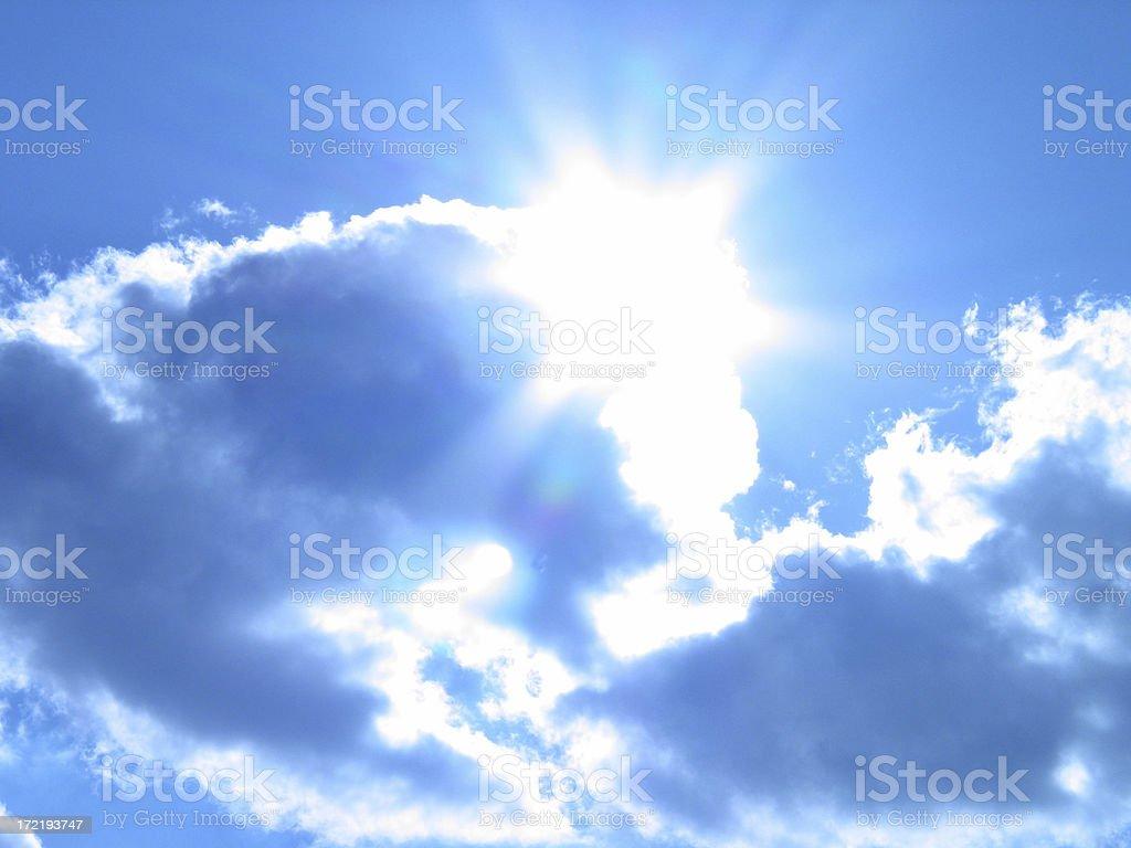 The Sun Breaks in a Tungsten Blue Sky #1 royalty-free stock photo