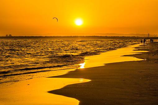 istock The sun goes down over the spanish border with Portugal at Isla Canela, Huelva 1032712936