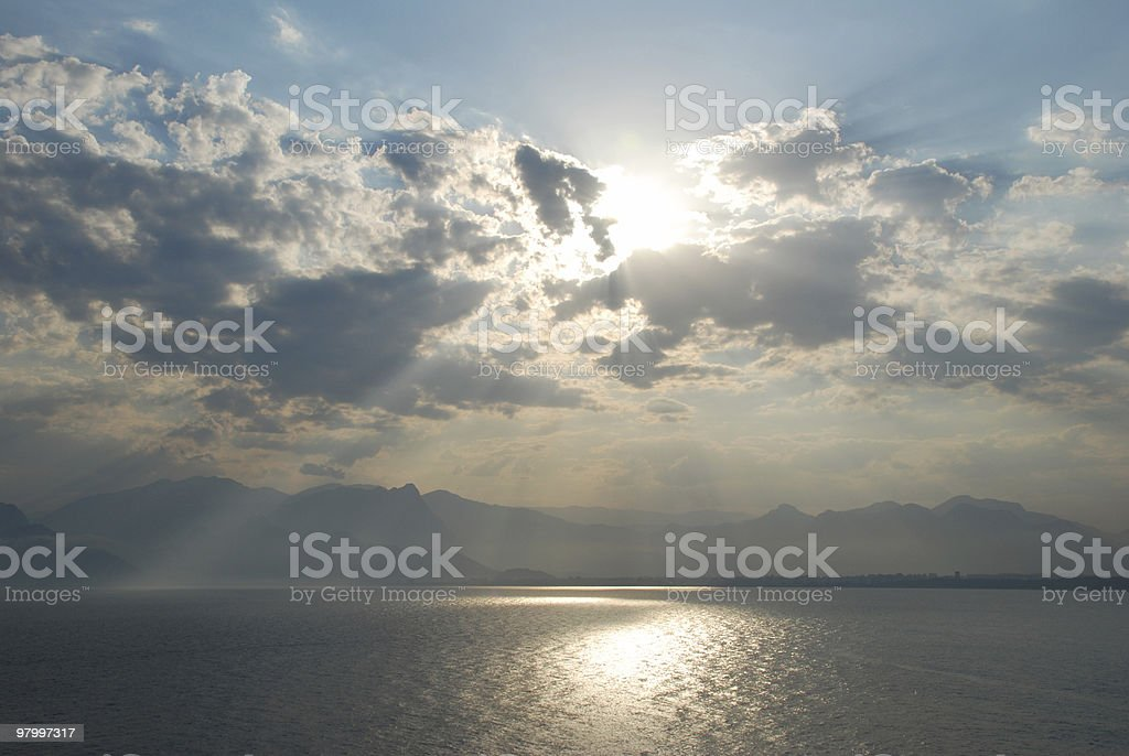 the sun is in back of clouds royalty-free stock photo