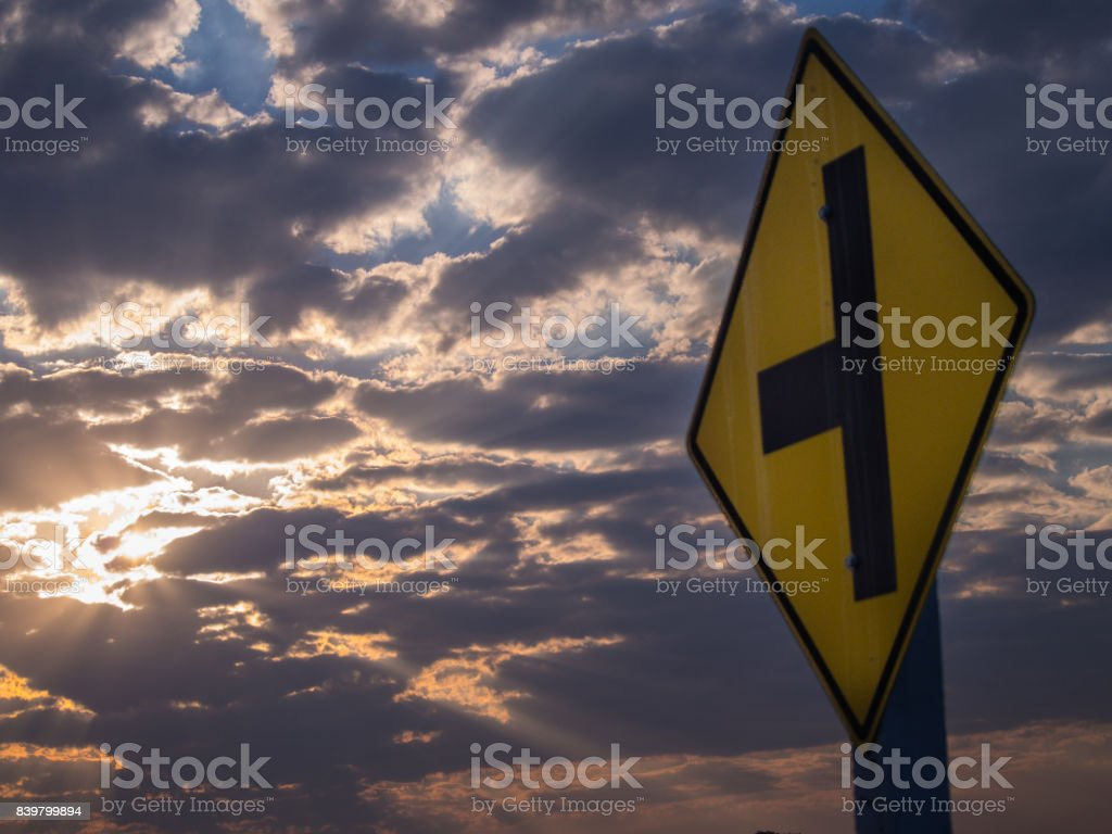 The Sun Light Through The Clouds in Traffic Sign stock photo