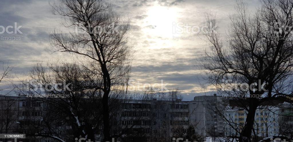 sun over the city in winter. Cold city. Winter sun.
