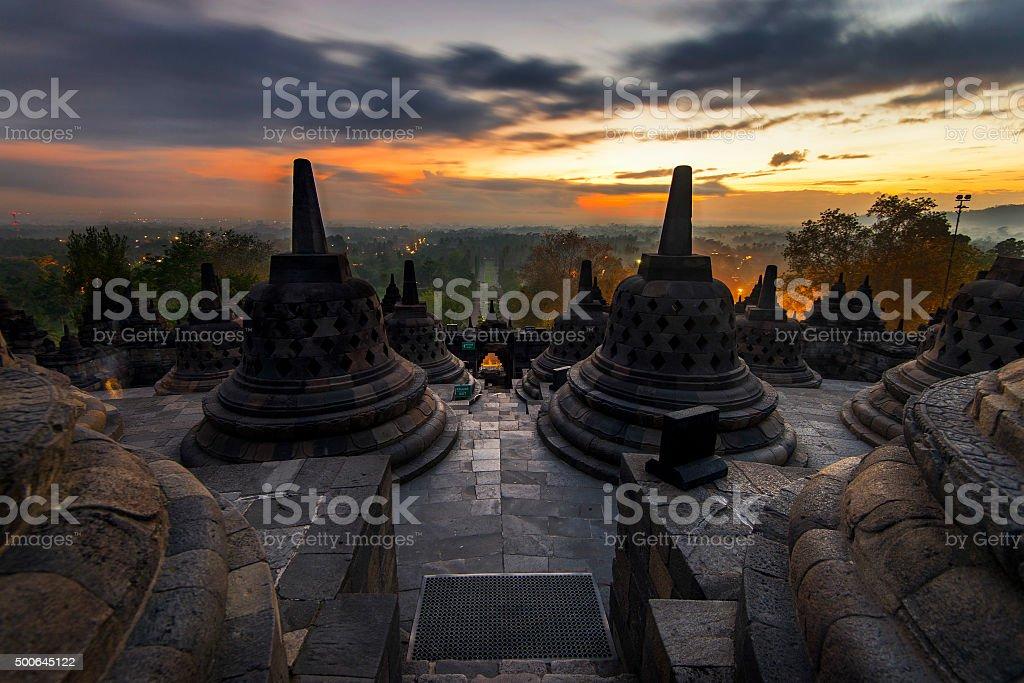 the sun rises in the Borobudur Temple in Indonesia. stock photo