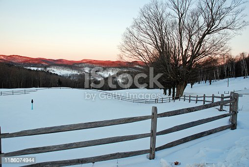 Sunrise is a quiet time on a farm in the winter in Vermont
