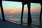 The sun rise, as seen from under the pier in Pensacola