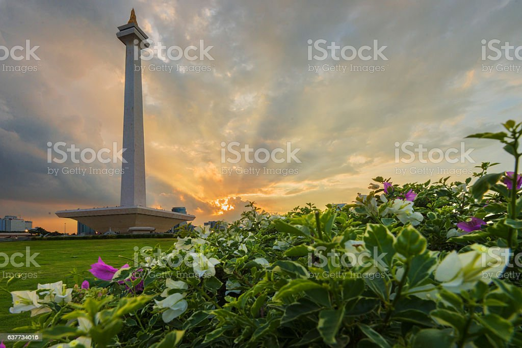 The sun set in the national monument of indonesia stock photo