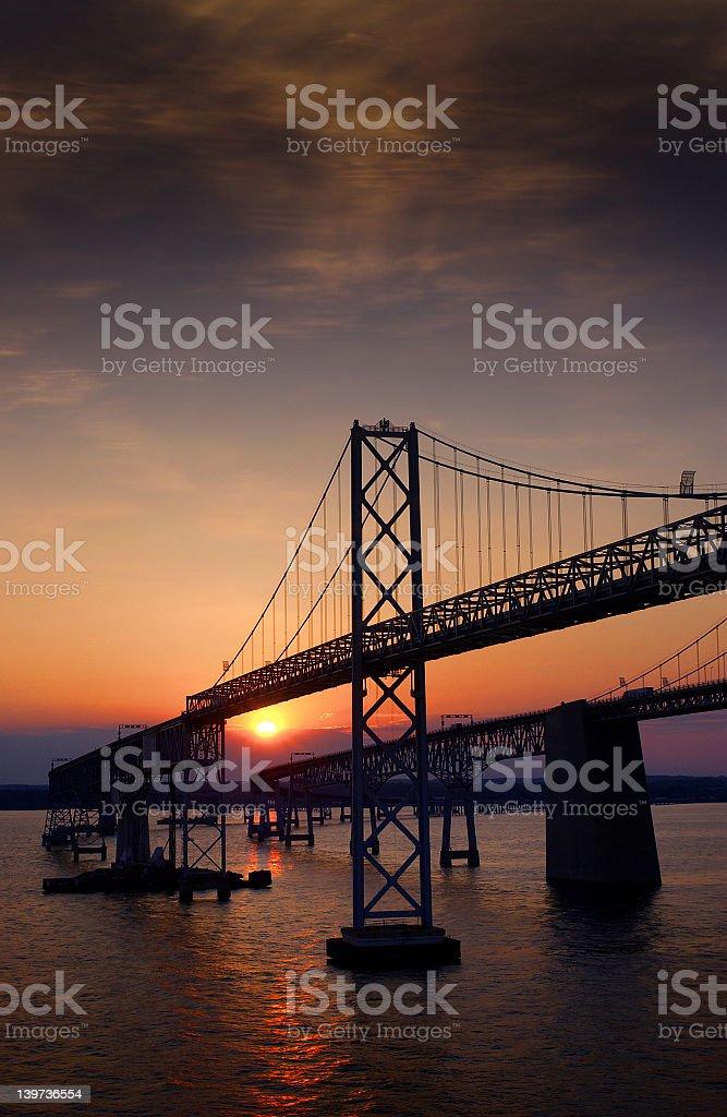The sun setting behind Chesapeake Bay Bridge royalty-free stock photo